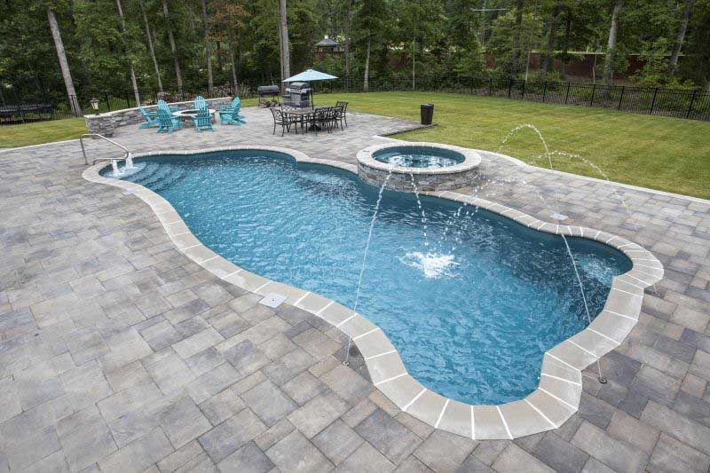 How Your Pool Builder Can Create a Stress Reducing Oasis